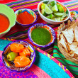 Mexican food varied chili sauces nachos lemon — Stock Photo #5282676