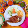 Fried mojarra tilapia fish Mexico style with chili sauce - Stock Photo