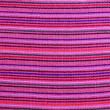 Royalty-Free Stock Photo: Mexican serape vibrant pink macro fabric texture
