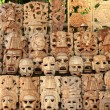 Royalty-Free Stock Photo: Mayan wood mask rows Mexico handcraft faces