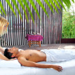 Stock Photo: Cranial sacral massage therapy in Jungle cabin