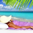 Caribbean tourist resting beach hat woman - Stock Photo