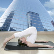 Black mat yoga woman window view city urban buildings — Stock Photo