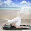 Black mat yoga woman window view of tropical beach — Stock Photo #5283878