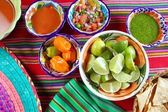 Mexican food varied chili sauces nachos lemon — Stock Photo