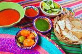 Mexican food varied chili sauces nachos lemon — Foto Stock