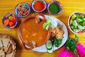 Shrimp seafood soup mexican chili sauces nachos — Stock Photo