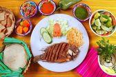 Fried mojarra tilapia fish Mexico style with chili sauce — Stock Photo