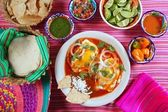 Breakfast Mexican ranchero eggs with chili and nachos — Stock Photo