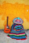 Mexican typical lazy man sombrero hat guitar serape — Photo