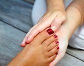Reflexology woman feet massage therapy — Stock Photo
