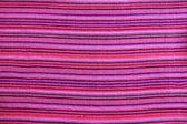 Mexican serape vibrant pink macro fabric texture — Stock Photo