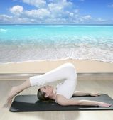 Black mat yoga woman window view of tropical beach — Stock Photo