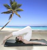 Black mat yoga woman window view palm tree beach — Stock Photo