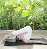 Black mat yoga woman window rainforest jungle view — Stock Photo