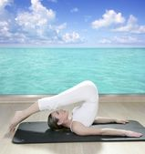 Black mat yoga woman window turquoise sea view — Stock Photo