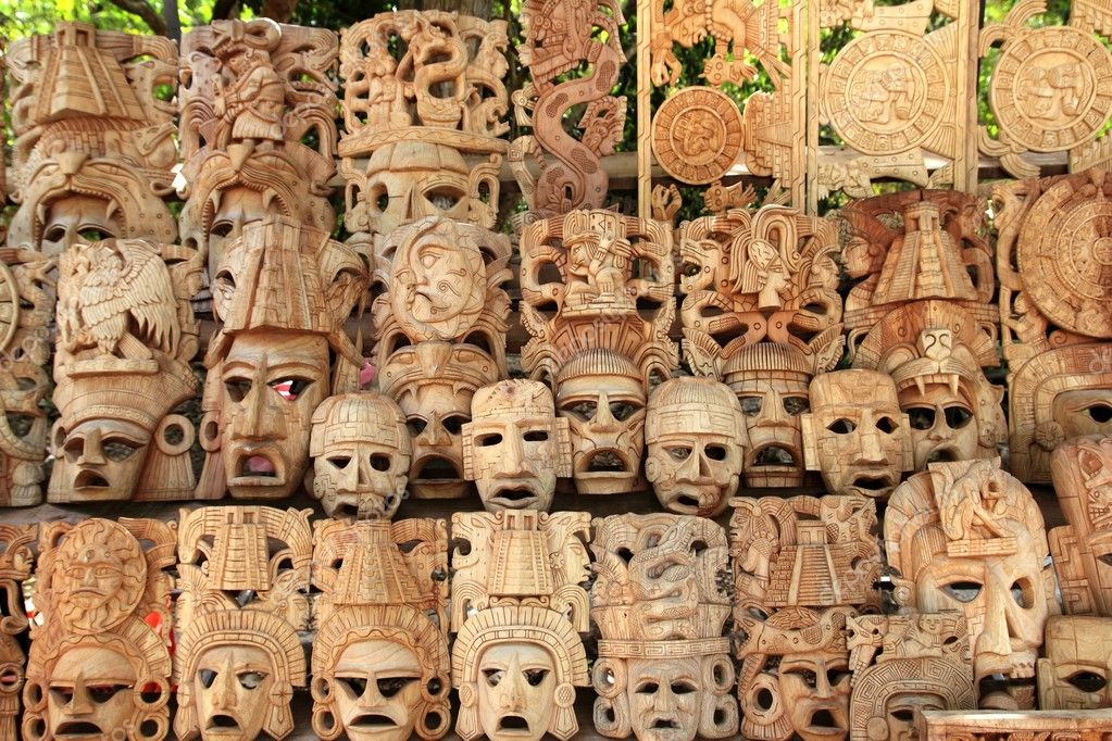 Mayan wood mask rows Mexico handcraft faces indian culture — Stock Photo #5282852