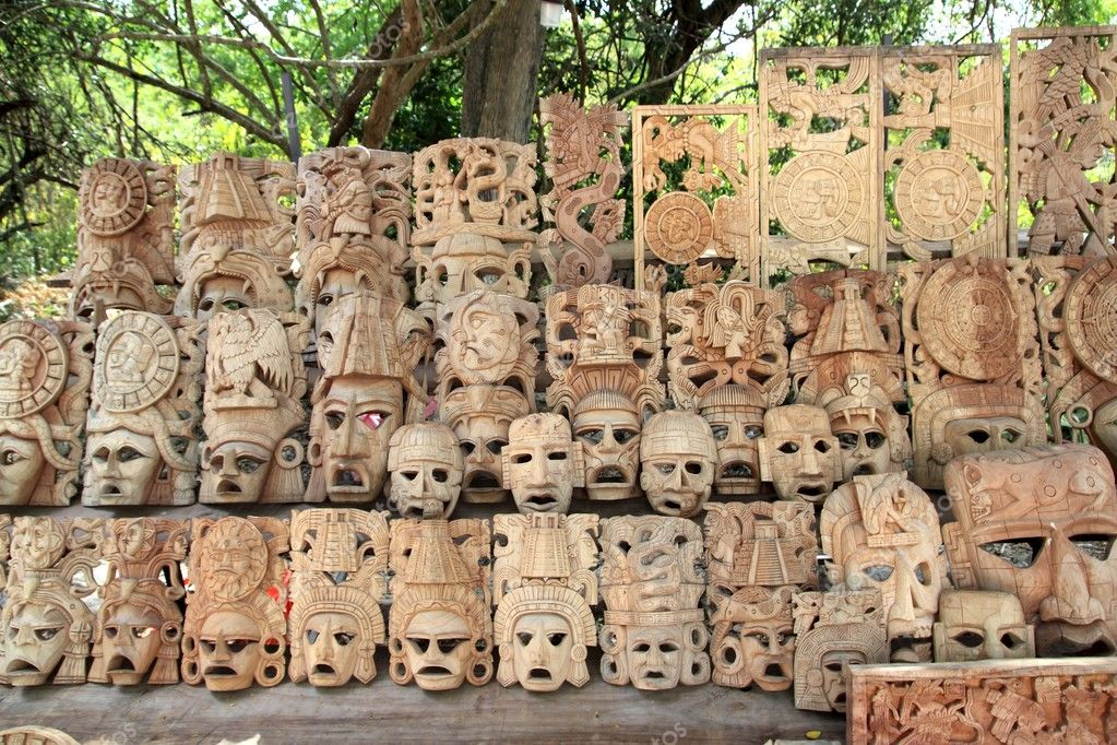 Mayan wood mask rows Mexico handcraft faces indian culture — Stock Photo #5282853