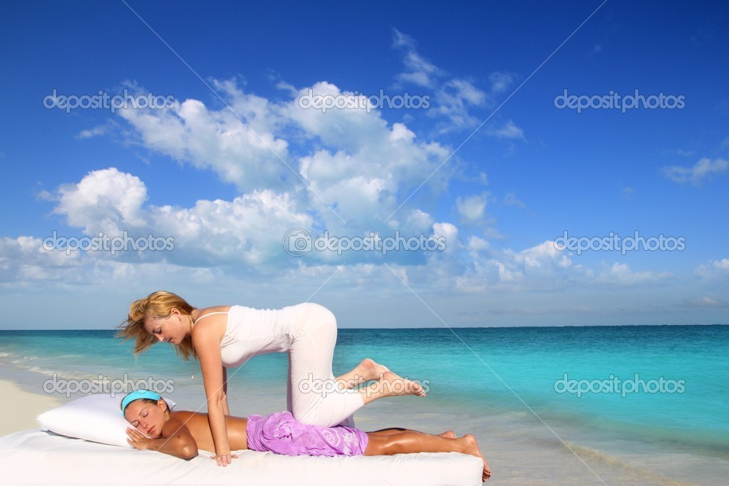 Caribbean beach therapy shiatsu massage on knees women in paradise — Stock Photo #5283718