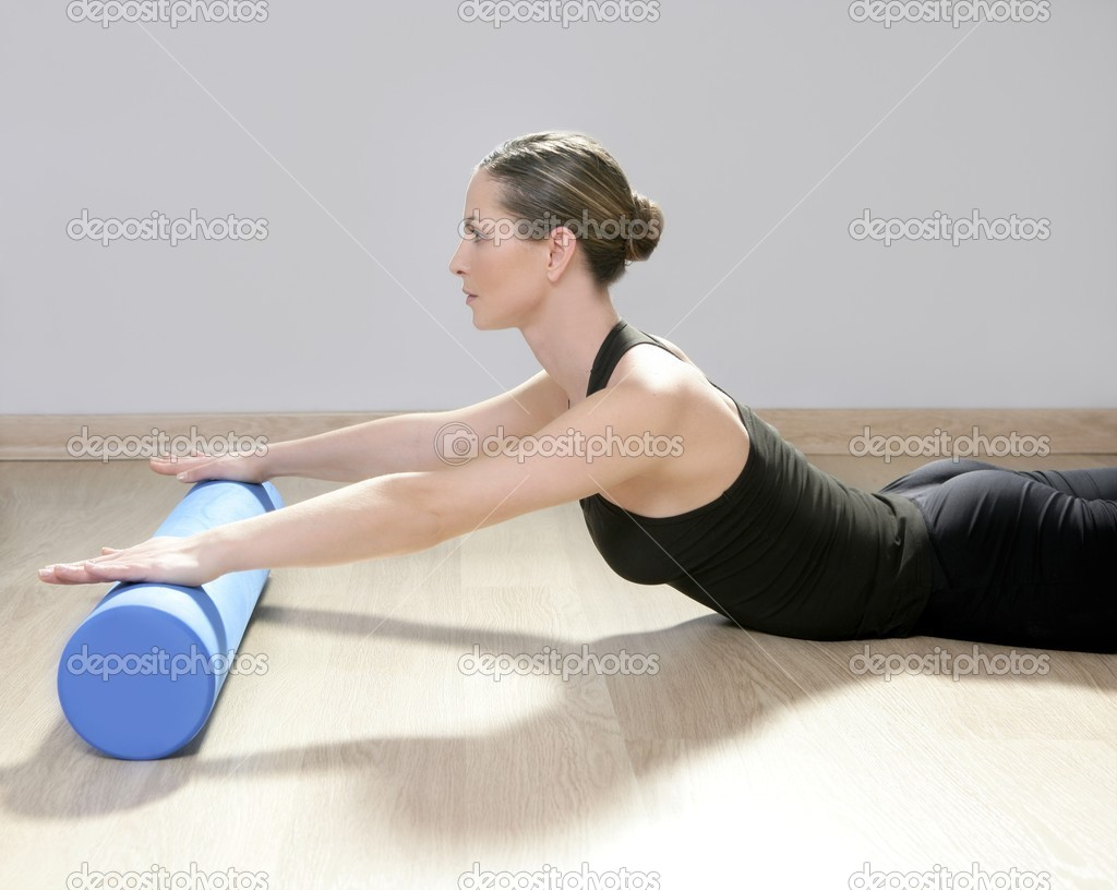 Blue foam roller pilates woman sport gym fitness yoga stock image