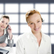 Beautiful operator women smiling and talking phone — Stock Photo