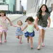 Four little girl group walking in the city — Stock Photo #5309131