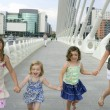 Four little girl group walking in the city — Stock Photo #5309135