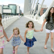 Four little girl group walking in the city — Stock Photo #5309138