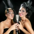 Beautiful women singing on a vintage microphone - ストック写真