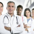 Expertise doctor multiracial nurse team row - Stock Photo