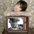 Royalty-Free Stock Photo: Retro woman in love with tv african hero