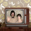 Wood old tv nerd silly couple retro man woman - Stock Photo