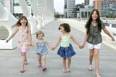Four little girl group walking in the city — Foto Stock