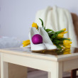 Wedding accessories next to the yellow tulips — Stock Photo