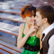 Young Couple Sitting On Park Bench — Stock Photo