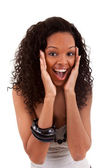 Closeup portrait of a surprised young black woman — Foto Stock