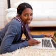 Stock Photo: Young black womusing laptop