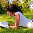 Young Student reading books at the school park — Stock Photo #5141447