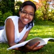 Young Student reading books at school park — Stockfoto #5141464