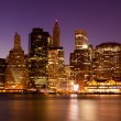 New York - Panoramic view  of Manhattan Skyline by night - Stock Photo