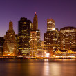 Stock Photo: New York - Panoramic view of ManhattSkyline by night