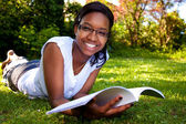 Young Student reading books at the school park — Foto Stock