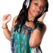 Stock Photo: Pretty young black girl listening music