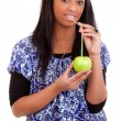 Young black woman drinking apple juice — Stock Photo