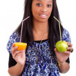 Stock Photo: Young black girl holding fruits