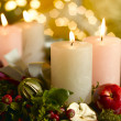 Advent wreath with a lighted candle - Stock Photo