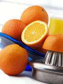 Orange and orange juice on white background — Stock Photo