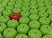 One red apple on a background of green apples — Stock Photo