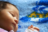 The small beautiful baby lying on a blanket — Stock Photo