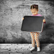 The small child with a board for drawing - Stock Photo